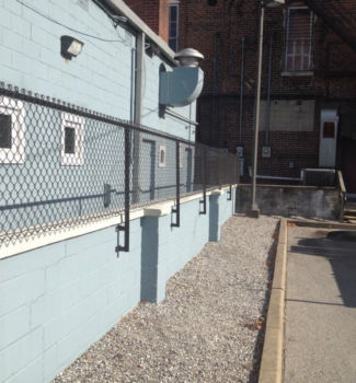 Face mounted chain link fence